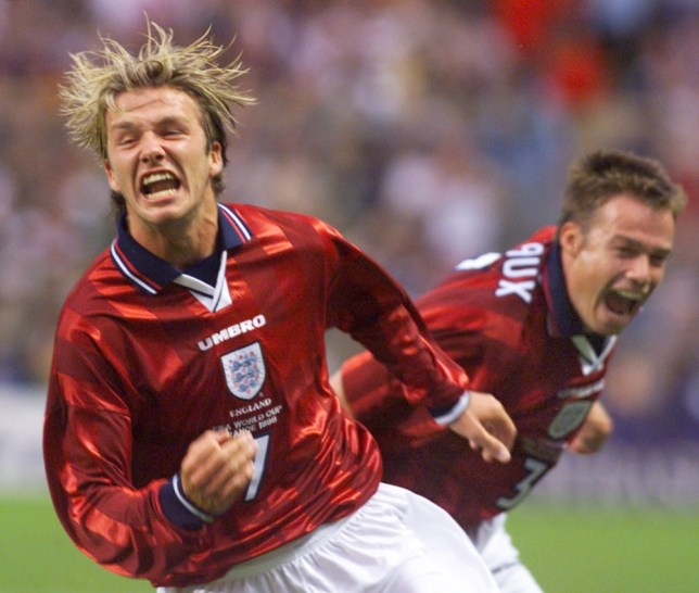 (FILES) In a file picture taken on 26 June 1998 English  midfielder David Beckham (L)jubilates after he scored the second goal of his team, next to teammate Graeme Le Saux at the Felix Bollaert stadium in Lens, northern France, during their 1998 Soccer World Cup group G first round match against Colombia. David Beckham is to retire from professional football at the end of the season, his representative announced on on May 16, 2013. The 38-year-old midfielder has played for Manchester United, Real Madrid and AC Milan, as well as winning 115 caps for England, and recently won the French Ligue 1 championship with Paris Saint-Germain. (ELECTRONIC IMAGE)    AFP PHOTO GERRY PENNYGERRY PENNY/AFP/Getty Images