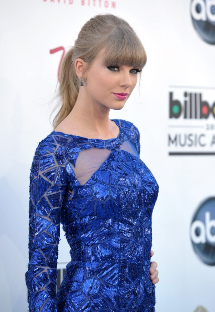 Taylor Swift insists she doesn't write about 'every man I date, only crazy love'