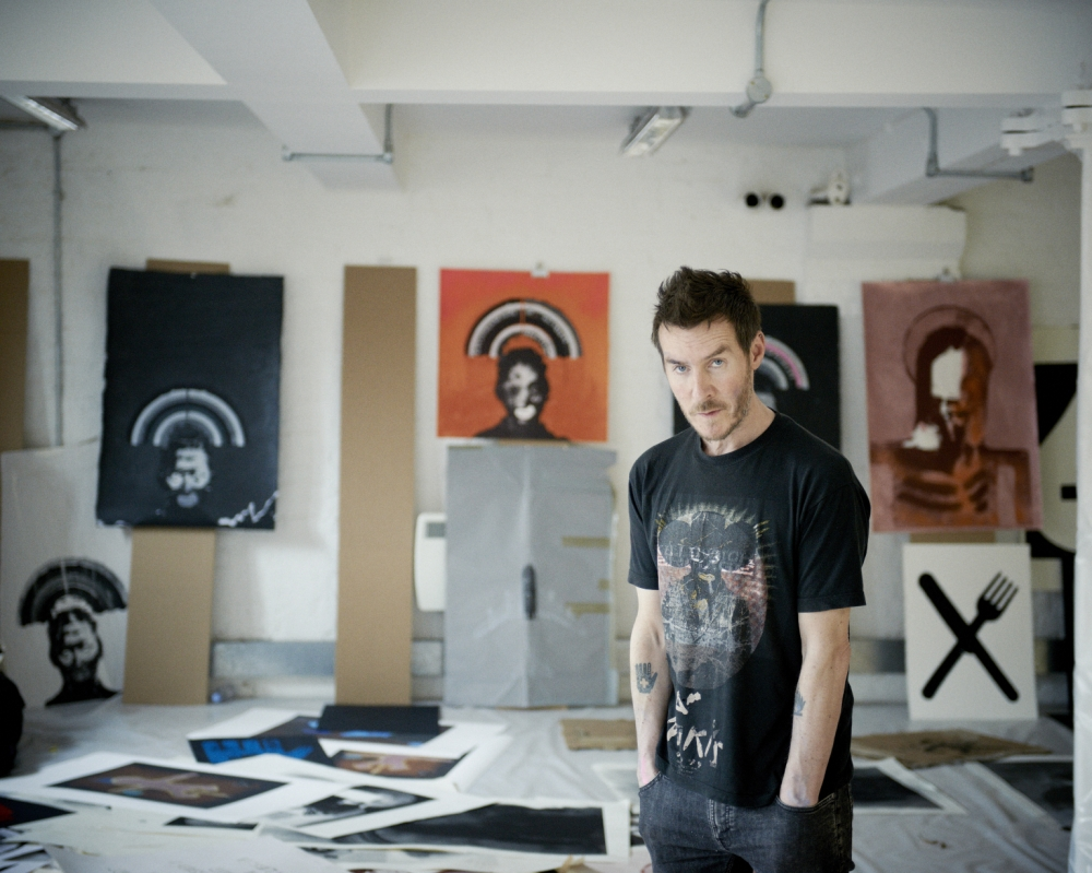 Robert Del Naja with artworks for his show, Fire Sale (Picture: Benjamin McMahon)