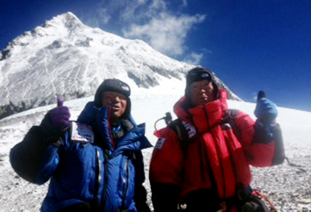 "This handout picture taken by Miura Dolphins on May 22, 2013 and received on May 23, 2013 shows 80-year-old Japanese adventurer Yuichiro Miura (R) and his son Gota (L) posing for a picture as they leave the C4 camp to ascent to the summit of Mount Everest in Nepal. Yuichiro Miura has reached the summit of Mount Everest, becoming the oldest person to reach the roof of the world, Nepalese tourism officials said on May 23.   AFP PHOTO / MIURA DOLPHINS ---EDITORS NOTE---HANDOUT RESTRICTED TO EDITORIAL USE - MANDATORY CREDIT ""AFP PHOTO / MIURA DOLPHINS"" - NO MARKETING NO ADVERTISING CAMPAIGNS - DISTRIBUTED AS A SERVICE TO CLIENTSMIURA DOLPHINS/AFP/Getty Images"