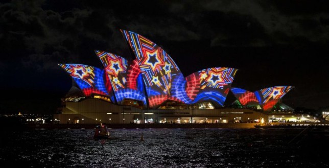The Opera House is lit up by a projection during Vivid Sydney, the annual festival of light, music and ideas, in Sydney on May 24, 2013. More than 60 interactive and immersive light sculptures and installations across Circular Quay, The Rocks, Walsh Bay, Darling Harbour and North Sydney took part in the festival. City skyscrapers will light up along with 3D mapped projections on Customs House, Museum of Contemporary Art Australia, and Cadmanís Cottage. SAEED KHAN/AFP/Getty Images