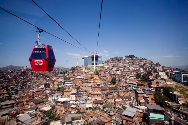Cable cars overlook the cluttered rooftops of Rio's Complexo do Alemão favela (Picture: Getty)