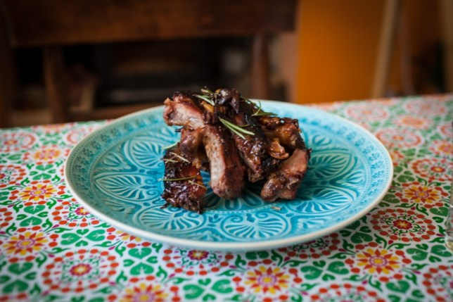 slow cooked pork ribs on a blue plate - serving suggestion