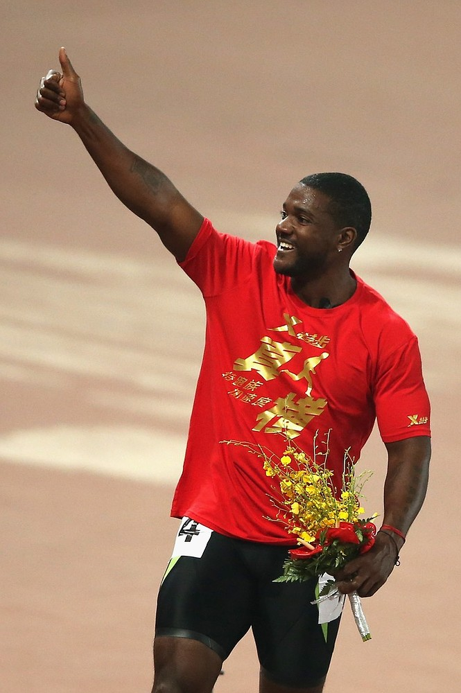 Last hurrah: Gatlin is chasing Bolt all the way (Picture: Getty Images)