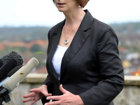 Australian PM Julia Gillard hits out at rival party's dig at her 'small breasts' and 'huge thighs' on fundraiser menu