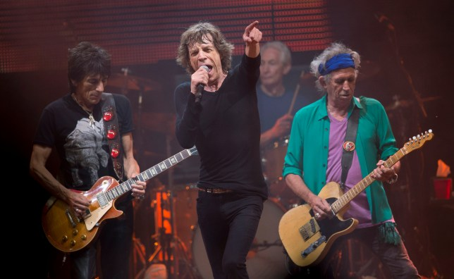 Mick Jagger, Ronnie Wood, Charlie Watts, on drums and Keith Richards