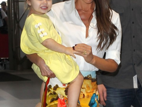 Mellow in yellow: A well behaved Harper Beckham jets off with Victoria