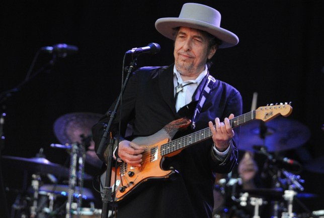 (FILES) - A picture taken on July 22, 2012 in Carhaix-Plouguer, western France shows US legend Bob Dylan performing on stage during the 21st edition of the Vieilles Charrues music festival. Bob Dylan's pot-smoking and protesting past will not, after all, prevent him from receiving France's highest honour. The US veteran folk singer has been nominated by Aurelie Filippetti, the culture minister and an avowed Dylan fan, to be awarded the Legion d'Honneur.  The move was thrown into doubt last month when Jean-Louis Georgelin, the Grand Chancellor of the Legion, blocked the nomination, reportedly because of reservations about Dylan's use of cannabis and anti-war politics. AFP PHOTO / FRED TANNEAUFRED TANNEAU/AFP/Getty Images