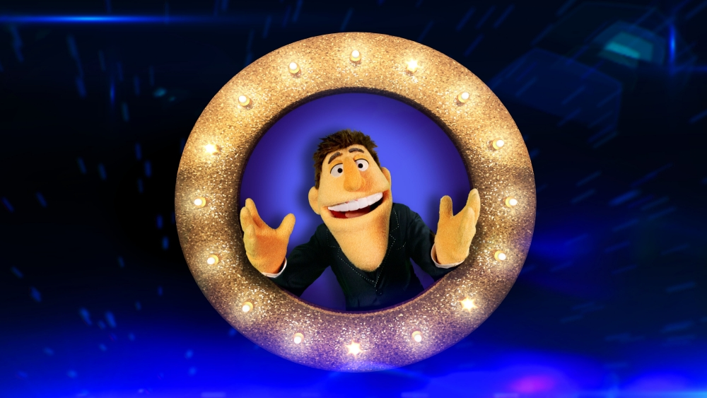 Embargoed to 0001 Thursday June 6  For use in UK, Ireland or Benelux countries only.  BBC undated handout photo of  Dougie Colon. BBC bosses have unveiled the new face of Saturday night entertainment - and it is made of felt, foam and belongs to a puppet.  PRESS ASSOCIATION Photo. Issue date: Thursday June 6, 2013. Colon - pronounced Cologne - has been created by the makers of The Muppets for new BBC1 series That Puppet Game Show, which will see him joined by star contestants such as Jonathan Ross, Richard Hammond and Jack Dee. Dougie has been loosely based on Vernon Kay, who will also be among the well-known figures appearing in the series.  See PA story SHOWBIZ Muppets. Photo credit should read: Guy Levy/BBC/PA Wire NOTE TO EDITORS: Not for use more than 21 days after issue. You may use this picture without charge only for the purpose of publicising or reporting on current BBC programming, personnel or other BBC output or activity within 21 days of issue. Any use after that time MUST be cleared through BBC Picture Publicity. Please credit the image to the BBC and any named photographer or independent programme maker, as described in the caption.
