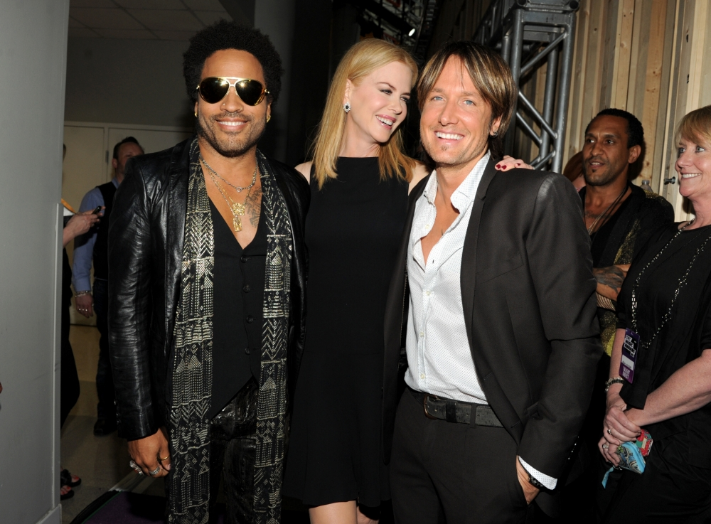 Awkward threesome: Nicole Kidman poses between husband Keith Urban and former fling Lenny Kravitz