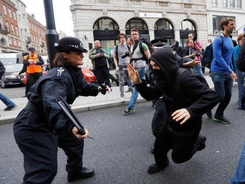 Riot police clash with anti-G8 protesters in central London