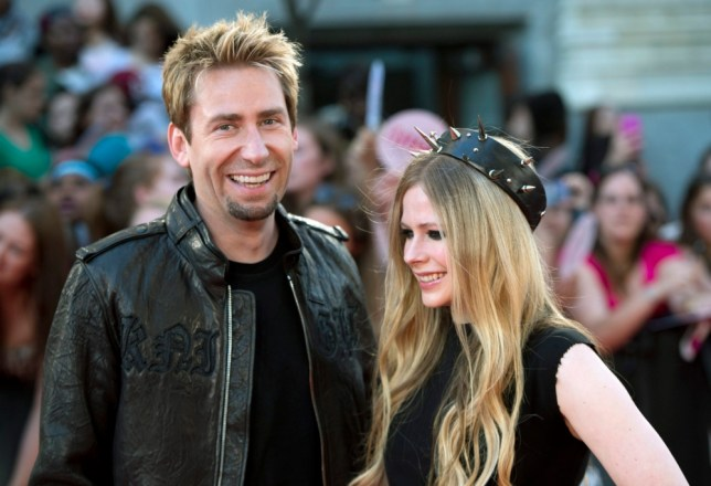 Chad Kroeger and Avril Lavigne pose on the red carpet during the 2013 MuchMusic Video Awards in Toronto on Sunday, June 16, 2013. (AP Photo/The Canadian Press, Nathan Denette)
