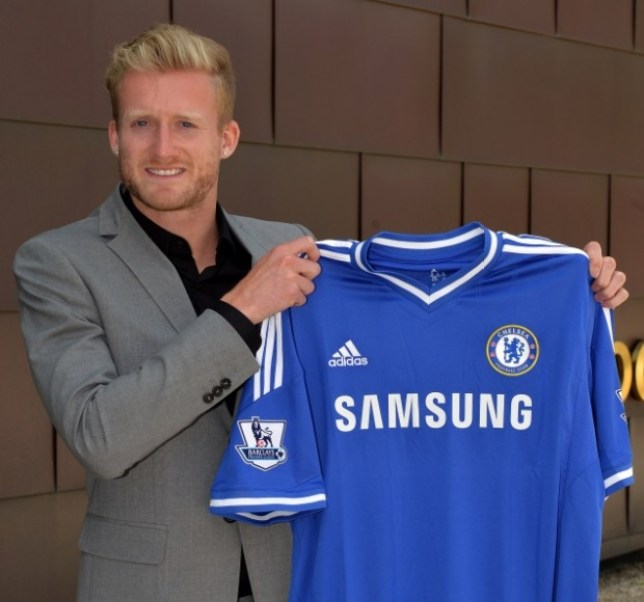 Chelsea FC via Press Association Images MINIMUM FEE 40GBP PER IMAGE - CONTACT PRESS ASSOCIATION IMAGES FOR FURTHER INFORMATION. Chelsea's new signing Andre Schurrle holds his new shirt at Cobham Training Ground on 25th June 2013 in Cobham, England.