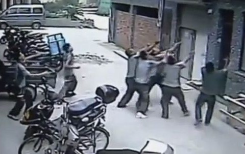 Video footage shows passers-by catching falling toddler
