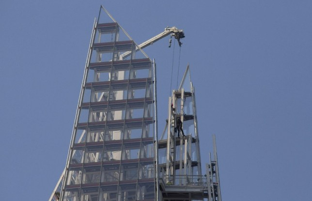 A Greenpeace demonstrator climbs the Shard building, in central London July 11, 2013. Greenpeace said on its website that the six women attempting to climb the Shard, the tallest building in Western Europe, were protesting against drilling for oil in the Arctic. Reuters