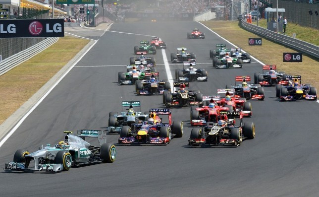 Mercedes' British driver Lewis Hamilton leads after the start at the Hungaroring circuit in Budapest on July 28, 2013 during the Hungarian Formula One Grand Prix. AFP/Getty Images