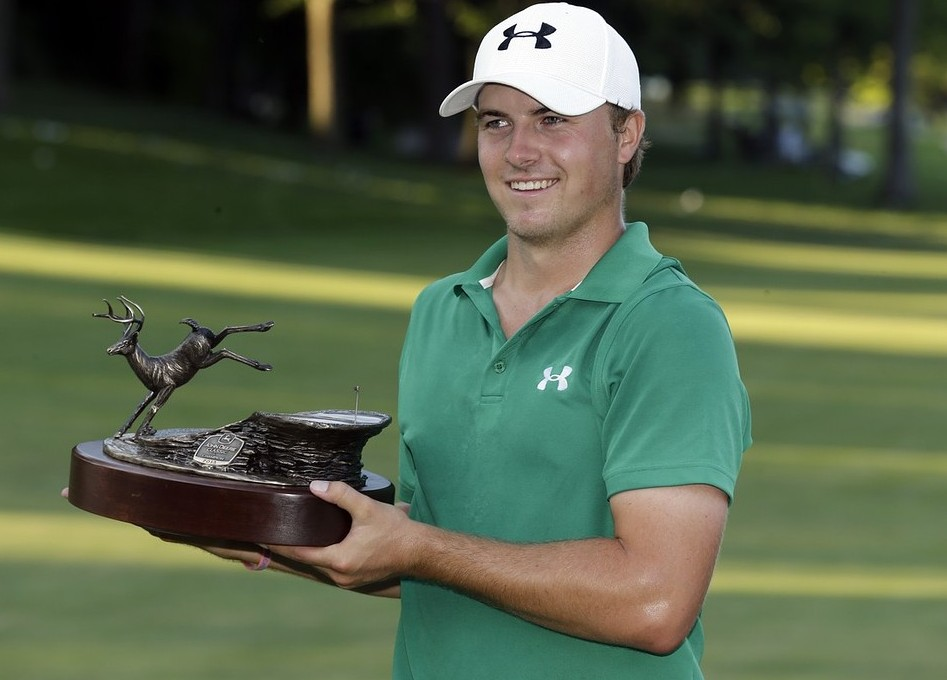 Jordan Spieth holds the trophy after winning the John Deere Classic golf tournament, Sunday, July 14, 2013, at TPC Deere Run in Silvis, Ill.  Spieth defeated Zach Johnson and David Hearn on the fifth hole of a playoff. AP