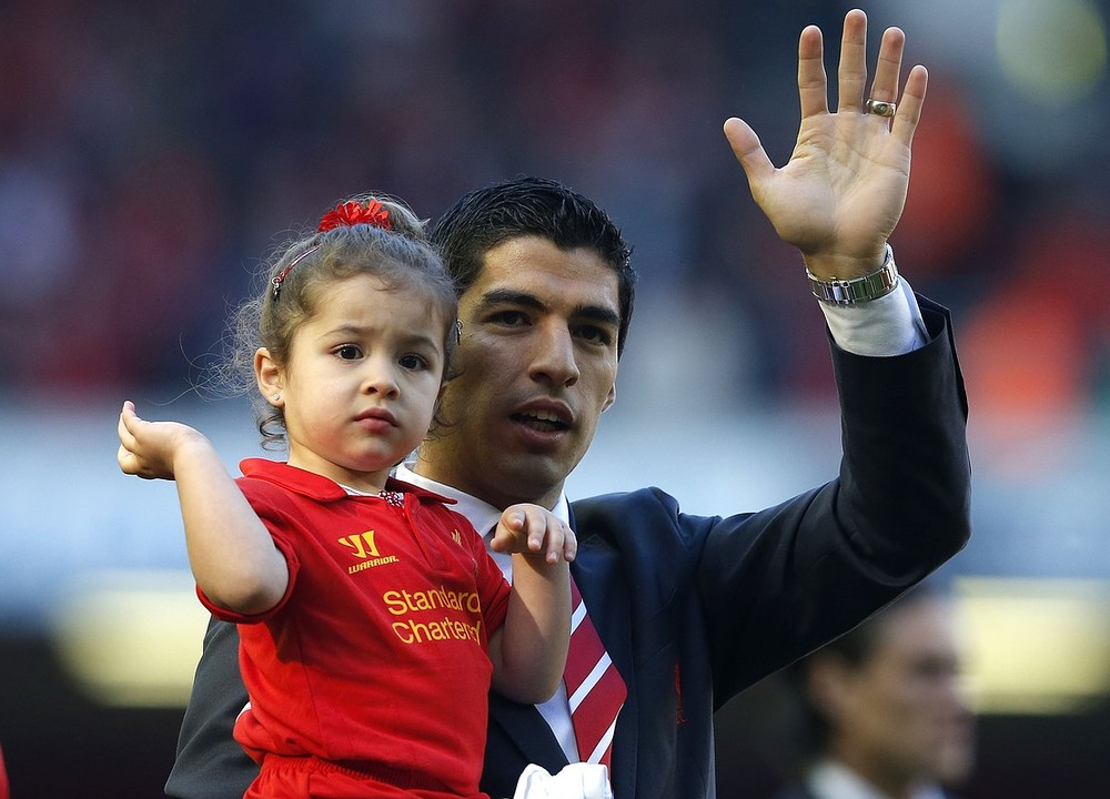 Liverpool confirm Arsenal's bid for Luis Suarez but insist the striker is not for sale