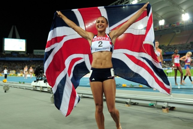 DAEGU, SOUTH KOREA - AUGUST 30:  Jessica Ennis of Great Britain celebrates with her country's flag after competing in the 800 metres and claiming silver in the women's heptathlon during day four of the 13th IAAF World Athletics Championships at the Daegu Stadium on August 30, 2011 in Daegu, South Korea.  (Photo by Stu Forster/Getty Images)