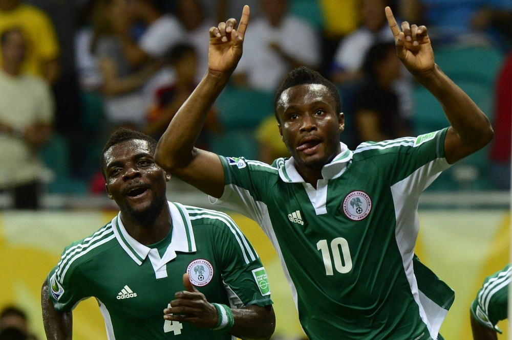 Nigeria's midfielder John Obi Mikel (R) celebrates after scoring against Uruguay during their FIFA Confederations Cup Brazil 2013 Group B football match, at the Fonte Nova Arena in Salvador, on June 20, 2013.   AFP PHOTO / DANIEL GARCIADANIEL GARCIA/AFP/Getty Images