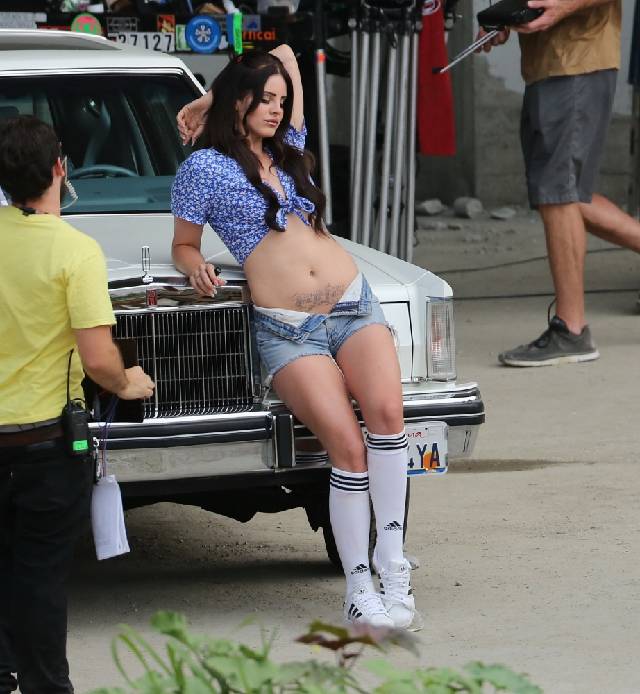 Lana Del Rey shows off her tats as a stripper in new music video