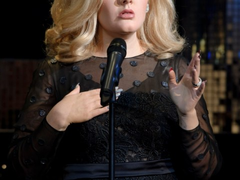 Adele gives the nod of approval as her Madame Tussauds waxwork is unveiled