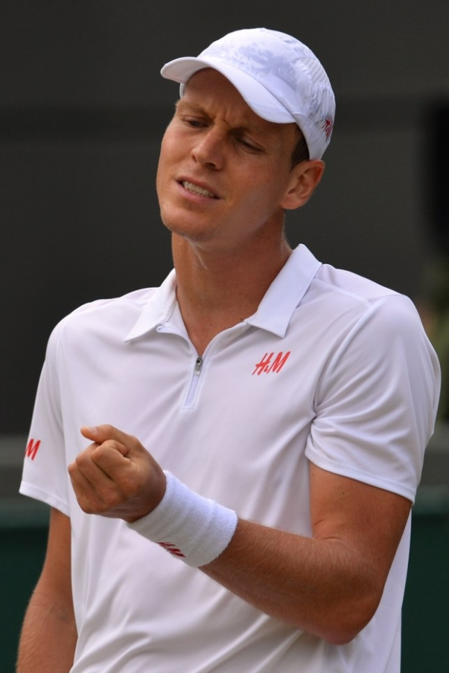 Czech Republic's Tomas Berdych reacts after missing a shot against Serbia's Novak Djokovic during their men's singles quarter-final match on day nine of the 2013 Wimbledon Championships tennis tournament at the All England Club in Wimbledon, southwest London, on July 3, 2013. AFP PHOTO / CARL COURT  -  RESTRICTED TO EDITORIAL USECARL COURT/AFP/Getty Images