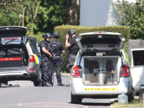 Kidlington siege: Toddlers released by armed father who remains in flat
