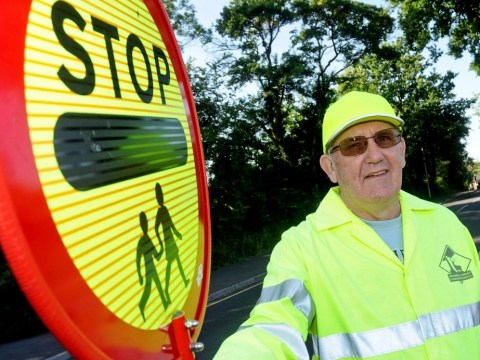 Lollipop man ordered to stop 'high-fiving' children on primary school crossing