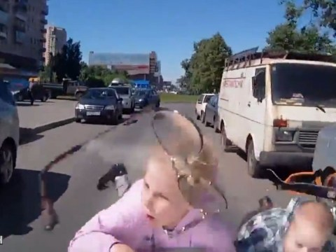 Dashboard camera video shows two children hit by car driving wrong way down one-way street
