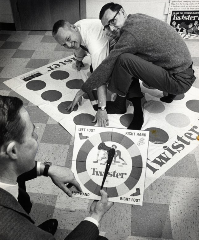 Charles Foley (left) plays one of the first versions of Twister with his co-inventor, Neil Rabens. Mr Foley died on July 1 (Picture: Pioneer Press/Buzz Magnuson)