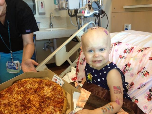 Thank you to the compassionate Reddit users who saw this photo and responded with a pizza delivery.  If you're on Reddit and have seen the adorable photo below, please help Children's Hospital Los Angeles and patient mom, Lauren Hammersley spread the word:  You've made a little girl very happy but NO MORE PIZZA IS NEEDED.  Pizza Room 4112 So many pizzas have been delivered that mom, Lauren, has taken the sign down. We agree with Reddit users. It can be difficult to turn down the request of a sick child, especially when it's a request for pizza.  So far twenty pizzas have been delivered to Hazel Hammersley's room and we are still counting.  HazelHoldsPizza Thanks Reddit users! Hazel is pictured holding one of over 20 pizzas she received today. Hazel's family has been busy today. Not only have they been keeping her occupied while she spends time in the hospital recovering but they have been giving away slices of pizza as fast as they can.  The Hammersley family will be going to bed very full and very thankful for the compassion they received today. But they've asked, respectfully, for everyone's help in spreading the word that no more pizzas are needed. Mom, Lauren, has taken down the sign from the hospital room window and is busy trying to share the news that the pizza has officially been delivered on Reddit.  On behalf of the Hammersley family, thank you for spreading the word and we hope the photo of Hazel with a successful pizza delivery received spreads just as far and fast as the original photo has.