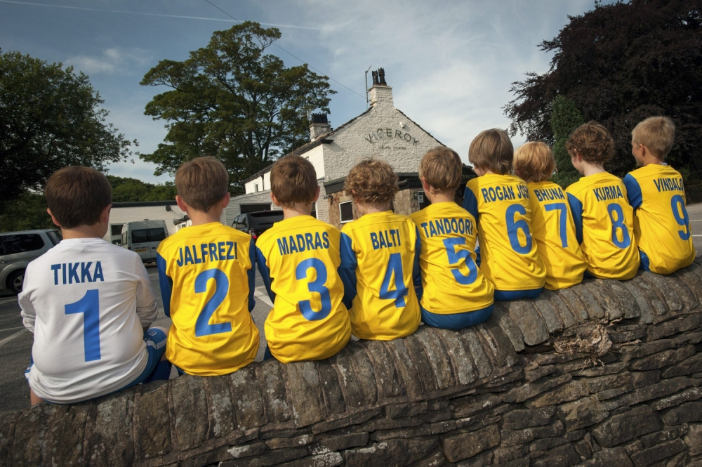 The Bollington Junior Football Club in Cheshire have got new sponsors and unusual football shirts after they joined up with the Viceroy Curry resturant, Bollington, Cheshire. The players have now changed their names to Spencer ëTikkaí Hall, Oliver ëJalfrezií Gaunt, Jackson ëMadrasí Mather, Will ëTandoorií Richardson, Caleb ëRogan Joshí Rogers, Sam ëBhunaí Baistow, Paddy ëKormaí Watts, and Tom ëVindalooí Boyd.