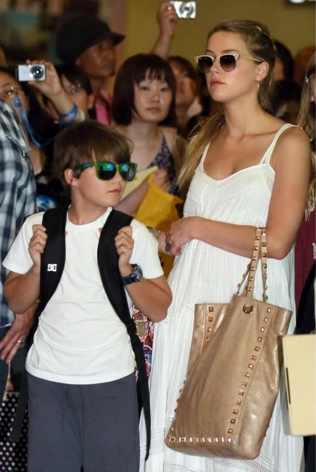 Mandatory Credit: Photo by Masatoshi Okauchi / Rex Features (2655508d)  Amber Heard and Jack Depp  Johnny Depp arriving at Narita International airport, Chiba, Japan - 16 Jul 2013