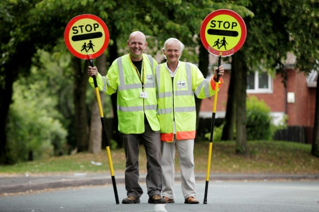"Lollipop man Darren Wardle (left) with his biological father Paul Ferris who is also a lollipop man. See NTI story NTILOLLIPOP.  An adopted man who traced his biological father has discovered that they were both working in the same profession, for the same council.  When Darren Wardle met his biological father Paul Ferris, he found that they both worked as lollipop men for Staffordshire County Council. Despite working just 15 miles away from each other, their paths never crossed.  Darren said: ""It definitely runs in the family, because my wife, mother-in-law and my Dad are all in the job. My adopted mother was also a lollipop lady for years in Wednesbury where I grew up, so from an early age I knew what was involved and valued the job that they do."""