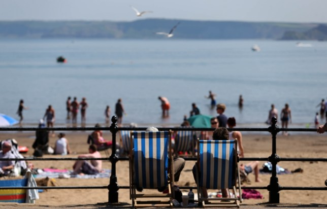 People enjoying the good weather on Scarborough beach, as the summer heatwave continues across the UK. PRESS ASSOCIATION Photo. Picture date: Thursday July 18, 2013. See PA story WEATHER Heatwave. Photo credit should read: Lynne Cameron/PA Wire