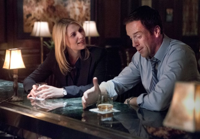 "This publicity image released by Showtime shows Claire Danes, left, and Damian Lewis in a scene from ""Homeland."" Danes was nominated for an Emmy Award for best actress in a drama series and Lewis was nominated for an Emmy Award for best actor in a drama series on Thursday July 18, 2013. The Academy of Television Arts & Sciences' Emmy ceremony will be hosted by Neil Patrick Harris. It will air Sept. 22 on CBS. (AP Photo/Showtime, Kent Smith)"