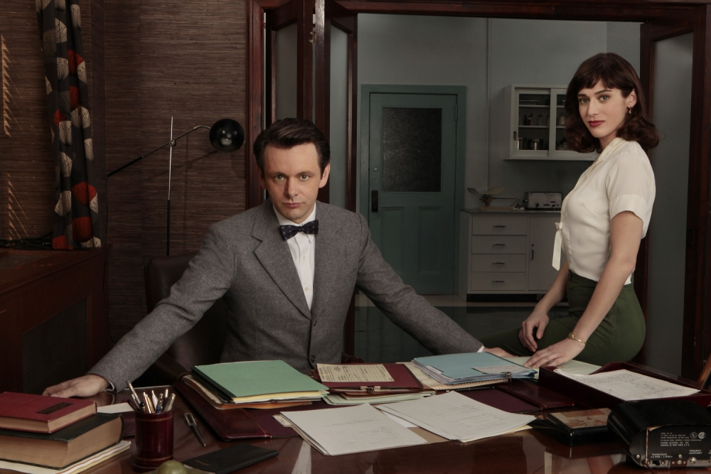 Embargoed to 0001 Monday July 22. Undated handout photo issued by Channel 4 of Michael Sheen (left) as Dr William Masters and Lizzy Caplan as Virginia Johnson in Masters of Sex, as the series will be shown on Channel 4 it has been announced. PRESS ASSOCIATION Photo. Issue date: Sunday July 21, 2013. Masters Of Sex features Welsh actor Sheen as gynaecologist William Masters, who carried out groundbreaking research - with partner Virginia Johnson - into arousal and sexual behaviour during the late 1950s and beyond. The series has already been among the recipients of the Critics' Choice television award for most exciting new series, despite not even debuting on TV in the US - where it has been made - until late September. The 12-part series looks at the real-life dramas of Masters and Johnson (played by Lizzy Caplan from True Blood), as well as the controversial research they carried out into desire, intimacy and orgasms. Sheen, whose notable appearances include his roles in The Queen, Frost/Nixon and the Twilight movies, has become an increasingly popular figure in the US. See PA story SHOWBIZ Sheen. Photo credit should read: Craig Blankenhorn/Showtime/Channel 4/PA Wire  NOTE TO EDITORS: This handout photo may only be used in for editorial reporting purposes for the contemporaneous illustration of events, things or the people in the image or facts mentioned in the caption. Reuse of the picture may require further permission from the copyright holder.