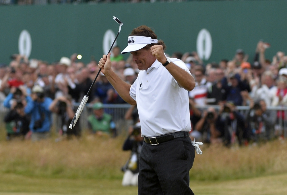 Phil Mickelson of the U.S. reacts after making his birdie putt on the 18th green during the final round of the British Open golf championship at Muirfield in Scotland July 21, 2013    REUTERS/Toby Melville (BRITAIN  - Tags: SPORT GOLF)