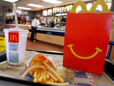 McDonald's profits rise 4% but the firm predicts a tough year ahead