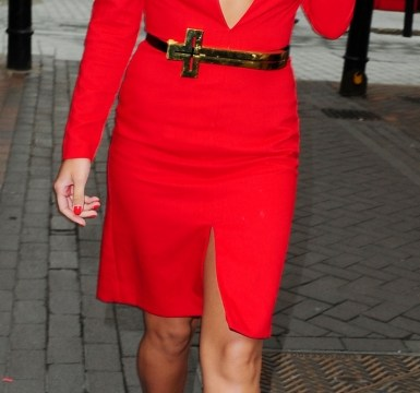 Mollie King does her best Holly Willoughby impression in daringly low-cut red dress