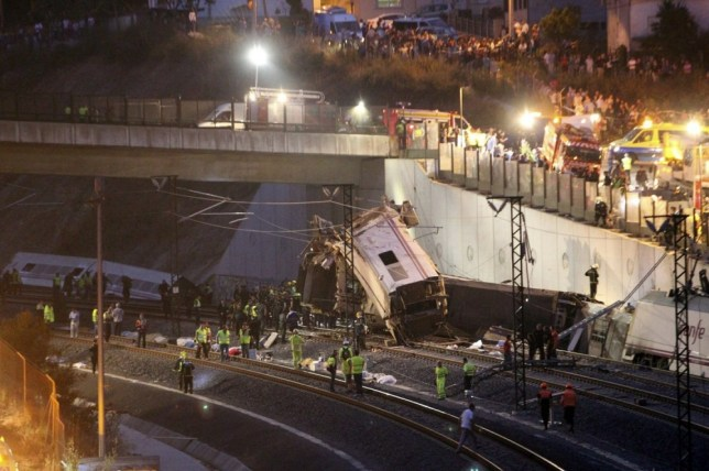 epa03800059 General view of the train accident of a train travellingfrom Madrid to Ferrol which was derailed close to Santiago de Compostela, Galicia, north east Spain on 24 July 2013.  Latest media reports suggest at least 10 persons killed with many more injuredb  EPA/SXENICK