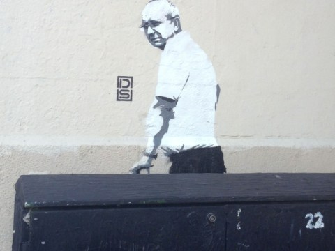 Graffiti artist paints image of cleaner removing artwork
