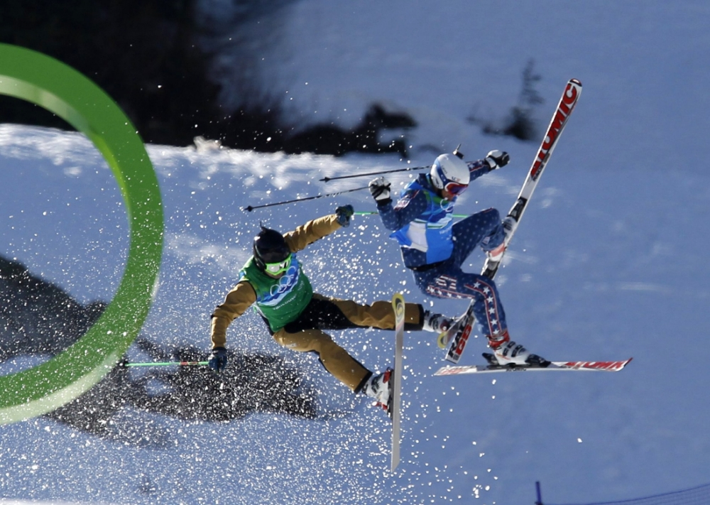 RNPS IMAGES OF THE YEAR 2010 - France's Ted Piccard (L) and Daron Rahlves of the U.S. fall during their ski cross freestyle skiing 1/8 finals at Cypress Mountain during the Vancouver 2010 Winter Olympics February 21, 2010.     REUTERS/Mark Blinch (CANADA - Tags: SPORT SKIING OLYMPICS)