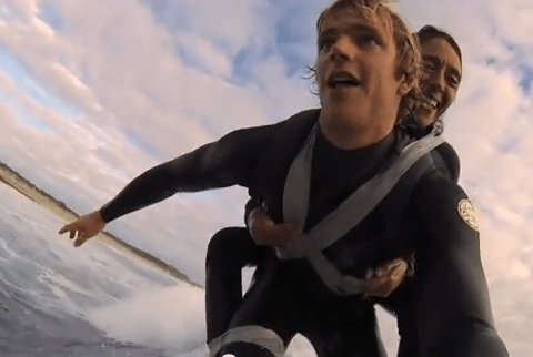 Watch: Paralysed woman duct-taped to surfer's back hits the waves