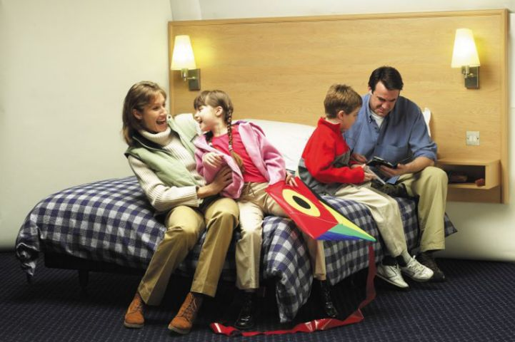 A family in hotel room