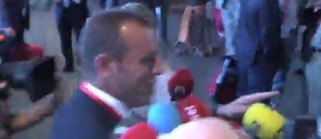 When you've got to go... Sandro Rosell points to the bathroom as he aims to escape questions. (Picture: YouTube)