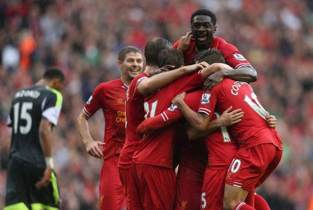 LIVERPOOL, ENGLAND - AUGUST 17:  Daniel Sturridge of Liverpool is congratulated by Iago Aspas,Lucas,Philuppe Coutinho and Kolo Toure after scoring the first goal during the Barclays Premier League match between Liverpool and Stoke City at Anfield on August 17, 2013 in Liverpool, England. Getty Images