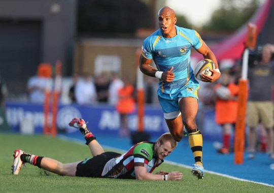 BARNET, ENGLAND - AUGUST 03:  Tom Varndell of London Wasps races clear to score a try against Harlequins defence during the J.P. Morgan Asset Management Premiership 7's at Allianz Park on August 3, 2013 in Barnet, England. Getty Images