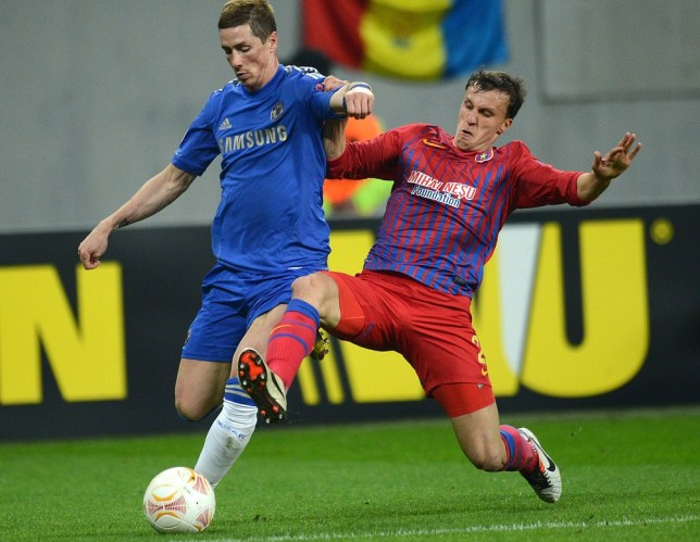 Vlad to meet you: Chiriches tackles Chelsea's Fernando Torres last season (Picture: Getty)